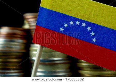 Venezuela Flag Waving With Stack Of Money Coins Macro