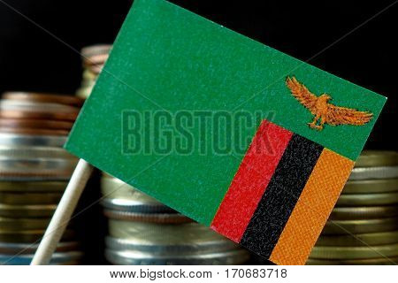 Zambia Flag Waving With Stack Of Money Coins Macro