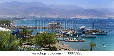 View on marina and central public beach of Eilat - famous resort city in Israel.  This serene location is a very popular tropical getaway for Israeli and European tourists