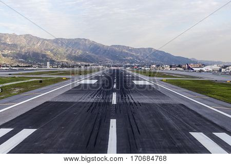Burbank, California, USA - January 26, 2017:  Skid marks on runway at Burbank airport near Los Angeles, California.