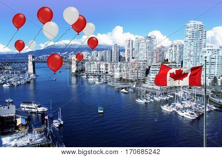 Canada day 150 celebrations. Canadian flag and red and white balloons in front of view of False Creek and the Burrard street bridge in Vancouver, Canada.
