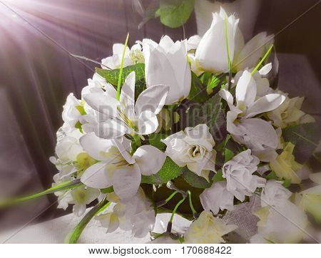Bouquet of artificial white flowers. Artificial light was added on the top left corner.