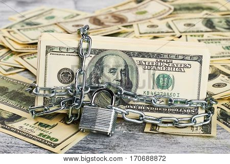 Money under lock and key. Create financial security.