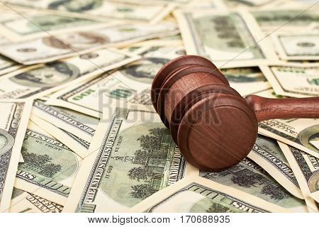 Chairman hammer and dollar bills. Court case on bribery.