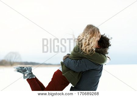 Love story for a couple, taken in winter on a frozen lake