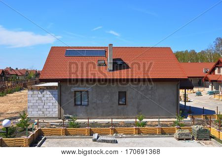 Solar Water Heater Solar Panels and Skylights Beautiful New Contemporary House with Solar water panel heating. Roofing Construction. House Construction. Solar panel for hot water system.