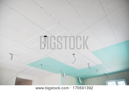 Ceiling construction details with electricity wire for lighting. Building gypsum plaster boards walls and ceiling. Ceiling Joists of Home Under Construction. Using Gypsum Board for Ceilings Section.