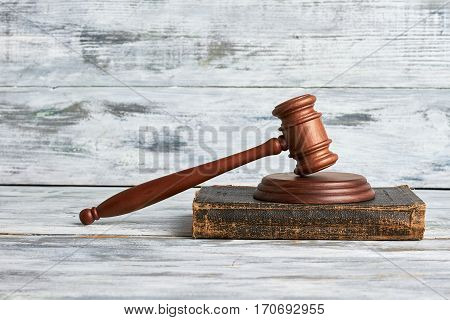 Law mallet on wooden surface. Justice will prevail.