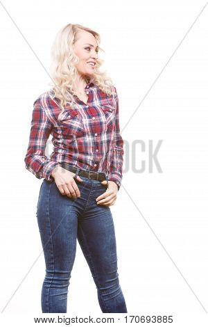 Middle aged blonde attractive woman wearing jeans pants plaid shirt posing studio shot isolated on white