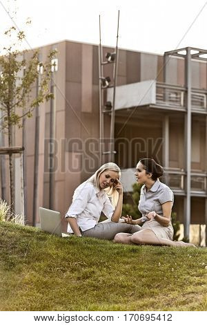 Young businesswomen arguing on office lawn