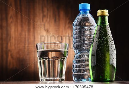 Composition With Glass And Bottles Of Mineral Water