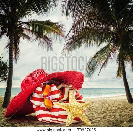 Beach bag on the beach at sunset