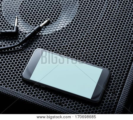 Template of black modern smartphone turned left with audio speaker background. Clipping path
