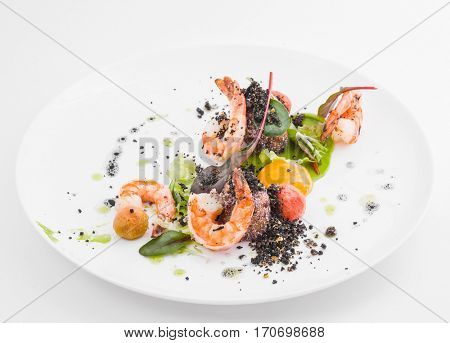 Delicacy appetizer of shrimp with pepper on white plate