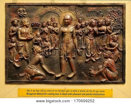 KOLKATA, INDIA - FEBRUARY 09, 2016.: Bhagavan Mahaviras waling tour is beset with pleasant and painful distractions, bass relief on the wall of Jain Temple (also called Parshwanath Temple) in Kolkata
