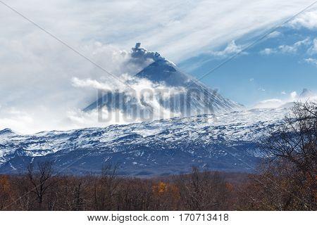 Kamchatka volcanic landscape: view of explosive-effusive eruption Klyuchevskoy Volcano (Klyuchevskaya Sopka) on a sunny weather. Russian Far East Klyuchevskaya Group of Volcanoes.