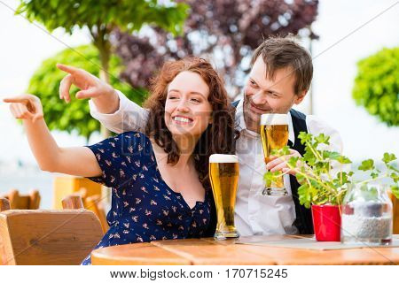 Man and woman sitting in beer garden pub