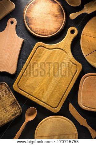 pizza cutting board at black background texture