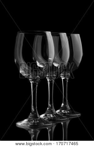 Three elegant wine glasses in a black background