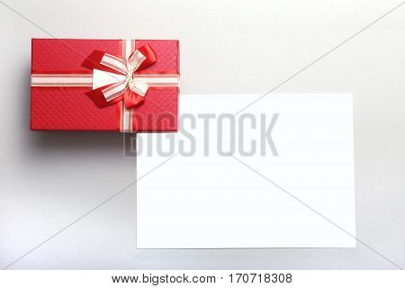 Beautiful gold, red present gift box and ribbons on backgound.