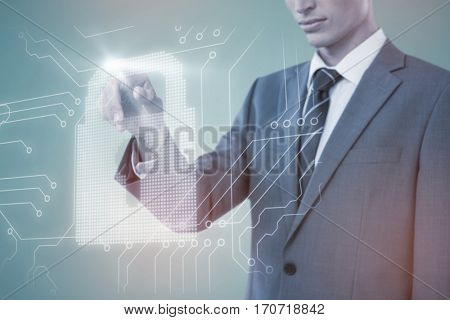 Midsection of elegant businessman pointing against green background