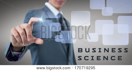Midsection of sophisticated businessman indicating against grey vignette
