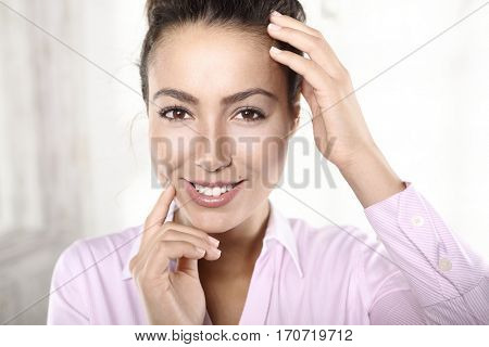 Closeup portrait of attractive young woman having an idea.