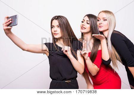 Three Models In Night Dresses Make Selfie On White