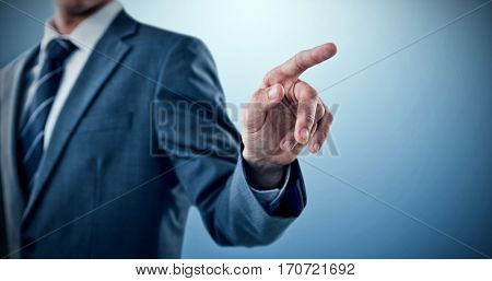 Midsection of well dressed businessman pointing against purple vignette