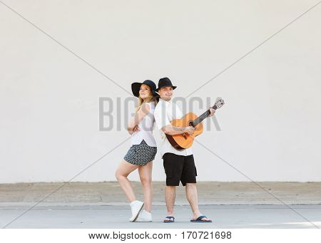 Relationship goals concept. Couple on romantic date. Man playing guitar and woman having fun