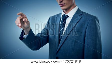 Midsection of elegant businessman pointing against purple vignette