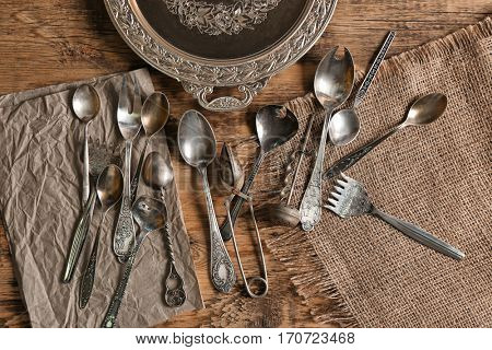 Set of silverware on wooden background