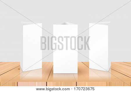 Blank Table Tent isolated on wooden table background. Paper vertical triangle cards on white background with reflections. Front. left and right view. Vector illustration.