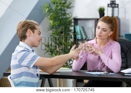 Depressed teenager having therapy session with therapist at office