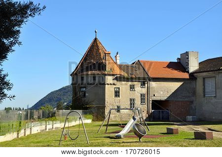 Сhildren's playground in front of the medieval monastery Klosterneuburg. Austria.