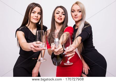 Three Smiling Young Women Celebrating And Open Champagne On The Party