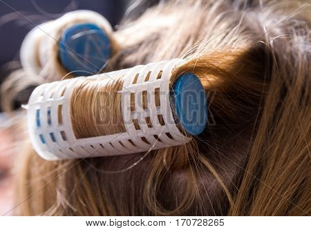 Close up of the curlers on head