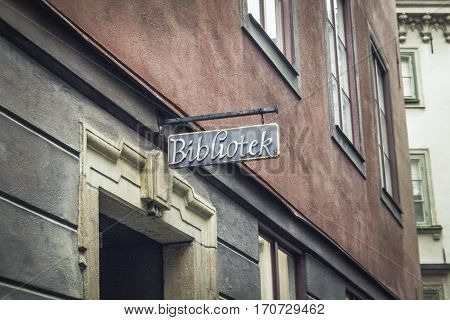 old library signboard on the threadbare building