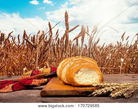 Bread on the table in wheat field