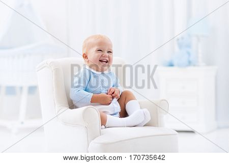 Baby Boy Playing In Bedroom