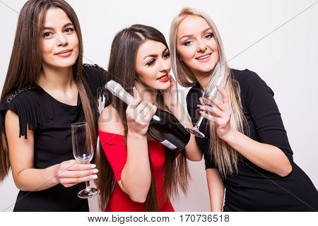 Young Women Celebrating And Open Champagne On The Party