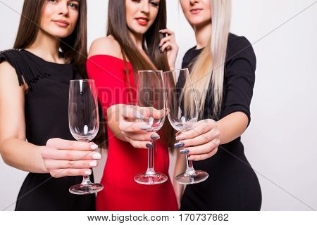 Smiling Young Women Celebrating With Empty Glasses On The Party