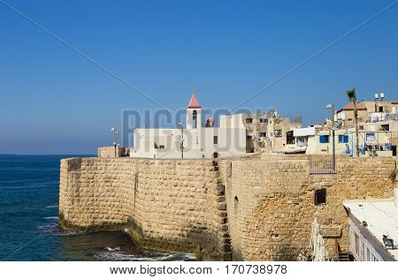 Christian St John's church in the old fortress of Acre Israel. View from the sea side. Mediterranean sea