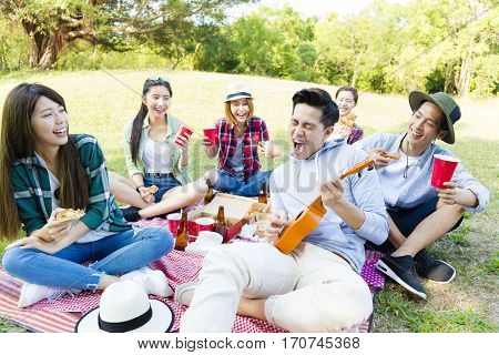 happy young asian group enjoying picnic party
