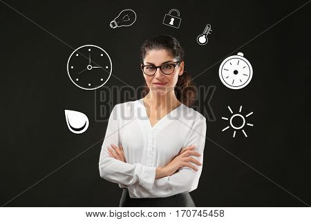 Business and time management concept. Mature woman on black background