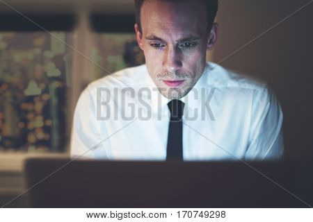 Close Up Of Businessman Working Overtime On Computer