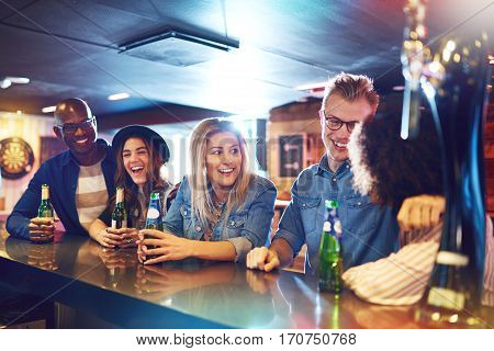 Group Of Happy People At Bar Counter