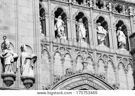 Toledo (Castilla-La Mancha Spain): exterior of the medieval cathedral in gothic style detail. Black and white