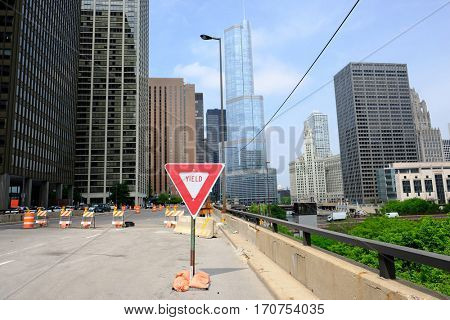 CHICAGO, IL - MAY 25: The Trump International Hotel and Tower with Yield sign in front,  May 25 2016 in Chicago, Illinois, USA