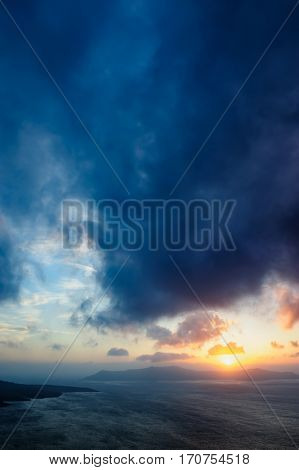 Dramatic colorful sunset at Santorini, Greece. View to caldera sea.